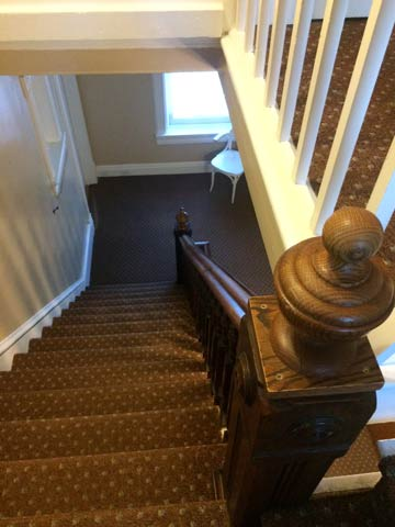 Stairs down from the third floor